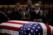 People pay respects as the remains of former US President George H. W. Bush lie in state in the US Capitol's rotunda December 3, 2018 in Washington, DC.