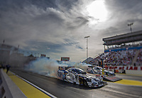 Apr. 5, 2013; Las Vegas, NV, USA: (Editors note: Special effects lens used in creation of this image) NHRA funny car driver Jack Beckman (near) does a burnout alongside John Force during qualifying for the Summitracing.com Nationals at the Strip at Las Vegas Motor Speedway. Mandatory Credit: Mark J. Rebilas-