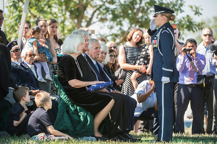 UNITED STATES - SEPTEMBER 07: Air Force Cpt. Jennifer Lee, salutes after presenting an American Flag to Terry Harmon, daughter of Women Airforce Service Pilot (WASP) Elaine Harmon, during a graveside service at Arlington National Cemetery, September 7, 2016. Citing space issues, WASPs were initially ineligible for inclusion at Arlington but after a petition challenging the rule, President Obama signed legislation that reversed it. Elaine Harmon passed away last year at age 95. Rep. Martha McSally, R-Ariz., seated at far right, sponsored the bill. (Photo By Tom Williams/CQ Roll Call)