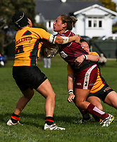 Atawhai Tupaea of Papakura is tackled.  Premier Women's Rugby League, Papakura Sisters v Manurewa Wahine, Prince Edward Park, Auckland, Sunday 13th August 2017. Photo: Simon Watts / www.phototek.nz