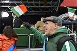 March 16, 2013 - New York, NY, U.S. - Man holding Irish flag as he marches past the television Live Broadcast area of the 252nd annual NYC St. Patrick's Day Parade,