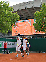 28-05-13, Tennis, France, Paris, Roland Garros, Doubbles Igor Sijsling and Robin Haase, on the background court Suzanne Lenglen