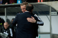 Swansea, UK. Thursday 20 February 2014<br /> Pictured: Garry Monk, Manager of Swansea City and Rafa Benitez, Manager of Napoli shake embrace before kick off<br /> Re: UEFA Europa League, Swansea City FC v SSC Napoli at the Liberty Stadium, south Wales, UK