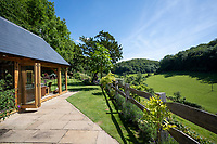 BNPS.co.uk (01202 558833)<br /> Pic: Strutt&Parker/BNPS<br /> <br /> A charming estate in the valley which provided the setting for the seminal book 'Cider with Rosie' has emerged on the market for £3.25million.<br /> <br /> The Dillay is nestled within the picturesque Dillay Valley, which was the home of the celebrated author Laurie Lee.<br /> <br /> In his 1959 novel, which has sold six million copies, he provides an account of his life there in the years that followed the end of World War One.<br /> <br /> The 164 acres estate, located in the Cotswold Area of Outstanding Natural Beauty, is hidden away in a secluded spot at the end of a long private drive.<br /> <br /> The main five bedroom farmhouse is made of Old Cotswold stone with a slate roof, and the property comes with two other lodges and a range of outbuildings.