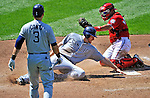 28 May 2011: San Diego Padres third baseman Chase Headley is tagged out at the plate by catcher Ivan Rodriguez to end the inning against the Washington Nationals at Nationals Park in Washington, District of Columbia. The Padres defeated the Nationals 2-1 to even up their 3-game series. Mandatory Credit: Ed Wolfstein Photo
