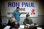 Volunteer Robert Terhune, right, signs up volunteers at Ron Paul's presidential campaign headquarters in Reno, Nev., January 31, 2012.