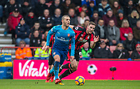 Jack Wilshere of Arsenal moves from Dan Gosling of AFC Bournemouth during the Premier League match between Bournemouth and Arsenal at the Goldsands Stadium, Bournemouth, England on 14 January 2018. Photo by Andy Rowland.