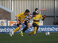 Kenny McLean shields the ball as he is tackled by Luke Leahy (left) and Bia-Bi Botti in the St Mirren v Falkirk Clydesdale Bank Scottish Premier League Under 20 match played at St Mirren Park, Paisley on 30.4.13. .