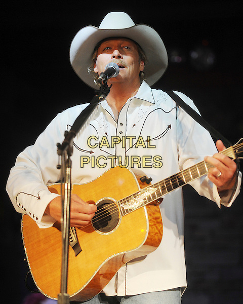 ALAN JACKSON.Is presented a photo collage from CMA representatives and CMA Board Chairman and artist Kix Brooks commemorating Jackson's 20th anniversary of signing a record deal with Arista records, Nashville, TN, .10 June 2009..country music half length cowboy hat white shirt microphone singing live concert gig on stage playing guitar .CAP/ADM/MS.©Mike StrasingerAdmedia/Capital Pictures