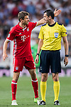 Thomas Muller (l) of FC Bayern Munich argues with referee Viktor Kassai during their 2016-17 UEFA Champions League Quarter-finals second leg match between Real Madrid and FC Bayern Munich at the Estadio Santiago Bernabeu on 18 April 2017 in Madrid, Spain. Photo by Diego Gonzalez Souto / Power Sport Images