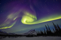 Aurora dances over Sukakpak mountain in the Brooks Range in Alaska's arctic.