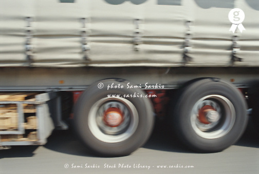 Truck driving on road, section (blurred motion) (Licence this image exclusively with Getty: http://www.gettyimages.com/detail/200387976-001 )