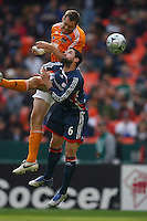 Houston Dynamo forward (21) Nate Jaqua out jumps New England Revolution defender (6) Jay Heaps for a header. The Houston Dynamo defeated the New England Revolution 2-1 in the finals of the MLS Cup at RFK Memorial Stadium in Washington, D. C., on November 18, 2007.