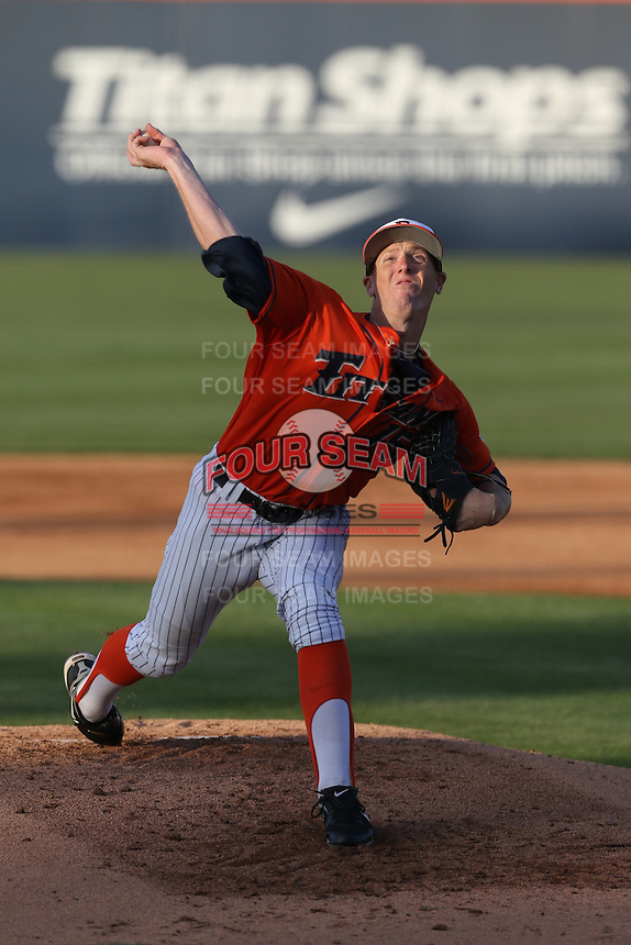 Thomas Eshelman (15) of the Cal State Fullerton Titans pitches during a game against the Cal Poly Mustangs at Goodwin Field on April 2, 2015 in Fullerton, California. Cal Poly defeated Cal State Fullerton, 5-0. (Larry Goren/Four Seam Images)