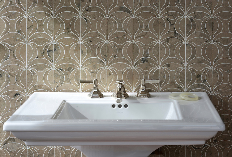 Calla, a natural stone waterjet mosaic shown in Jura Grey honed, is part of the Miraflores Collection by Paul Schatz for New Ravenna.