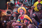Kayapo indigenous warriors watch a cultural presentation at the first ever International Indigenous Games, in the city of Palmas, Tocantins State, Brazil. The games will start officially with an opening ceremony on Friday the 23rd October. Photo © Sue Cunningham, pictures@scphotographic.com 21st October 2015