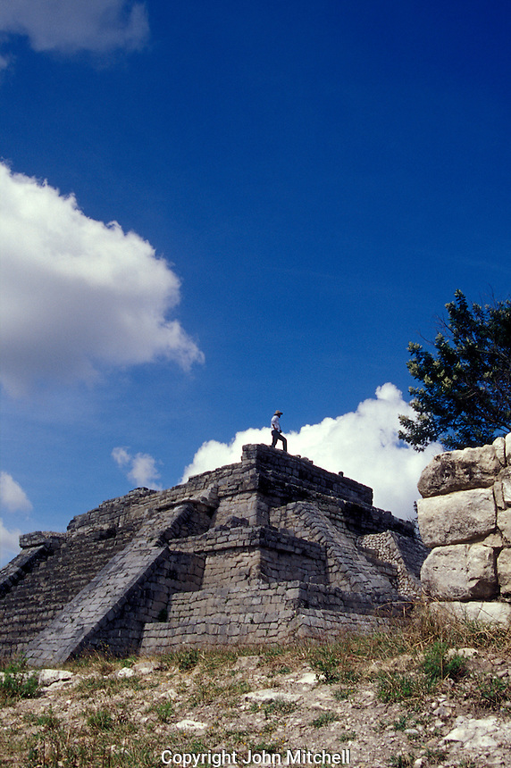 Tourist on top of the Acroplois, the main structure at at the Mayan ruins of Chinkultic near Comitan, Chiapas, Mexico