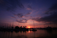 A beautiful Hawaiian sunset shows its true colors at the Ala Wai Yacht Harbor.
