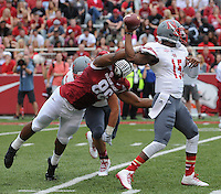 STAFF PHOTO ANTHONY REYES &bull; @NWATONYR<br /> Trey Flowers, Razorbacks defensive end, pressures Kalen Henderson Nicholls State quarterback in the first quarter Saturday, Sept. 6, 2014 at Razorback Stadium in Fayetteville.