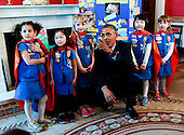 UNited States President Barack Obama poses with a group of 6 year old Girls Scouts from Tulsa, Oklahoma who designed a battery powered page turner to help people who are paralyzed or have arthritis at the 2015 White House Science Fair, a celebration of students winners of STEM (Science, technology, engineering and math) competitions from across the country on March 23, 2015, at the White House, in Washington, DC. <br /> Credit: Aude Guerrucci / Pool via CNP