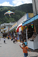 Child flying a kite in Banos, Ecuador