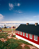 GREENLAND, Ilulissat, Disco Bay, exterior of houses with church