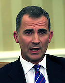 King Felipe VI of Spain makes remarks to the press pool following a meeting with United States President Barack Obama in the Oval Office of the White House in Washington, DC on Tuesday, September 15, 2015.<br /> Credit: Dennis Brack / Pool via CNP