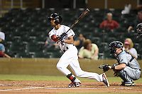Salt River Rafters outfielder Byron Buxton (2) at bat in front of catcher Justin O'Conner during an Arizona Fall League game against the Peoria Javelinas on October 17, 2014 at Salt River Fields at Talking Stick in Scottsdale, Arizona.  The game ended in a 3-3 tie.  (Mike Janes/Four Seam Images)
