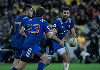 France's Kevin Gourdon passes to France's Maxime Medard during the Steinlager Series international rugby match between the New Zealand All Blacks and France at Westpac Stadium in Wellington, New Zealand on Saturday, 16 June 2018. Photo: Dave Lintott / lintottphoto.co.nz