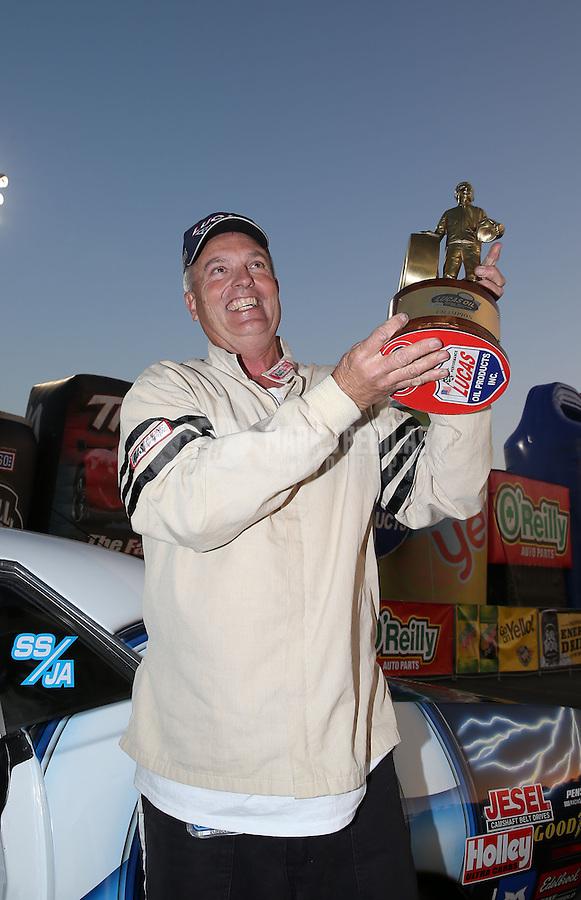 Feb. 17, 2013; Pomona, CA, USA; NHRA super stock driver Mike Cotten celebrates after winning the Winternationals at Auto Club Raceway at Pomona. Mandatory Credit: Mark J. Rebilas-