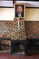 Rwanda. Southern province. Gitarama. District of Muhanga. Portrait of the rwandese president Paul Kagame and an empty chimney. Circle tray in rattan hanged on the bricks wall. Paper rosette. © 2007 Didier Ruef