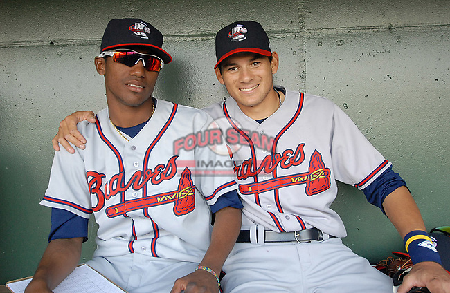 Outfielder Ramon Flores (25), right, of the Rome Braves, asked to have his photo taken in the dugout with his friend Julio Teheran (27), left, just before a game against the Greenville Drive April 13, 2010, at Fluor Field at the West End in Greenville, S.C. Photo by: Tom Priddy/Four Seam Images