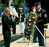 Washington, D.C. - May 29, 2006 -- United States President George W. Bush participates in a wreath laying ceremony at the Tomb of the Unknowns at Arlington National Cemetery in Arlington, Virginia  on May 29, 2006.  The President and first lady were at Arlington for the annual Memorial Day Commemoration honoring fallen American heroes.<br /> Credit: Ron Sachs  - Pool via CNP