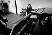 Moscow, Russia  .1998 .Anna Skryleva, a 23-year-old concert pianist student practices for an up coming performance with her professor in the Rachmaninoff room of Moscow's famous Tchaikovsky conservatory..