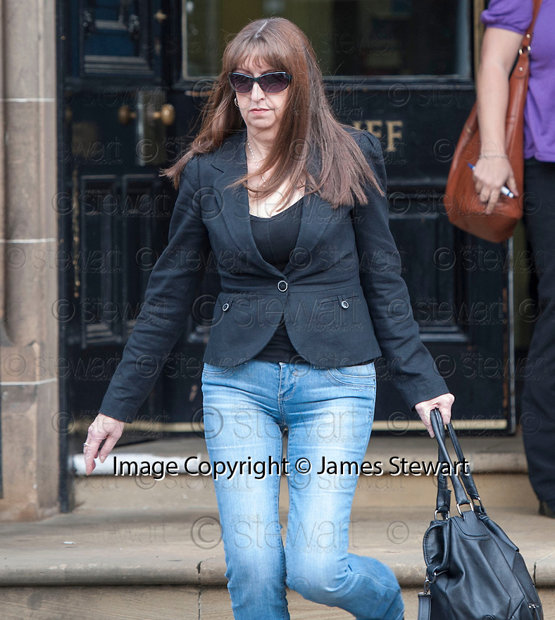 A woman, believed to be the mother of Bannockburn High School teacher Bernadette Smith, leaves Stirling Sheriff Court.