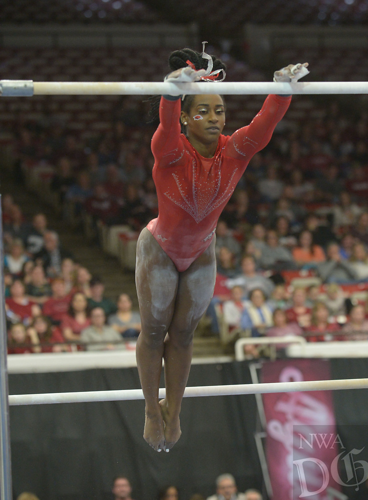 NWA Democrat-Gazette/ANDY SHUPE<br /> Arkansas' Hailey Garner competes in the bars Saturday, Jan. 5, 2019, during the Razorbacks' meet with No. 2 Oklahoma in Barnhill Arena in Fayetteville. Visit nwadg.com/photos to see more photographs from the meet.
