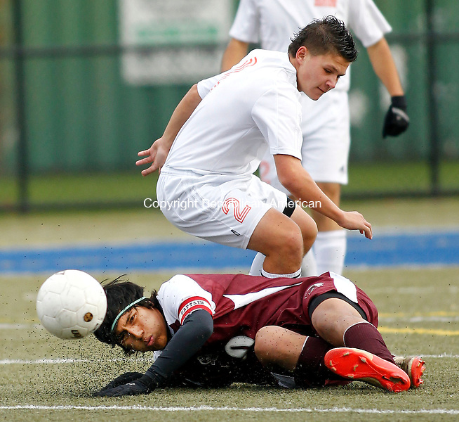 Waterbury, CT-03 November 2012-110312CM11-  Torrington's Jairo Borja hits the ground after colliding with Watertown's Brandon Rinaldi (2) during their NVL championship game Saturday afternoon at Municipal Stadium in Waterbury.  Watertown took home the victory, winning 2-1 in overtime. Christopher Massa Republican-American