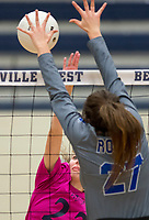 NWA Democrat-Gazette/CHARLIE KAIJO Bentonville West High School Kortney Puckett (22) blocks during the girl's volleyball game on Thursday, October 12, 2017 at Bentonville West High School in Centerton.