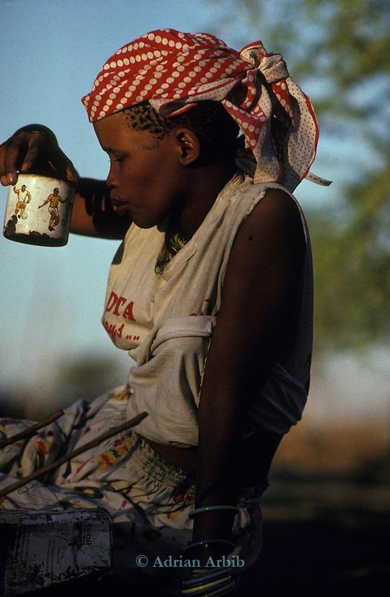 A San Bushman  girl in her  village, Tchumkwe, Bushman development foundation.  Namibia.