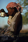 A San Bushman  girl in her  village, Tchumkwe, Bushman development foundation.  Namibia.