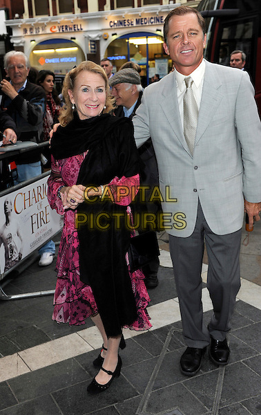 Juliet Mills and Maxwell Caulfield.Chariots of Fire gala night, Gielgud Theatre, Shaftesbury Avenue, London, England..July 3rd, 2012.full length pink dress pashmina scarf black married husband wife grey gray suit jacket .CAP/CJ.©Chris Joseph/Capital Pictures.