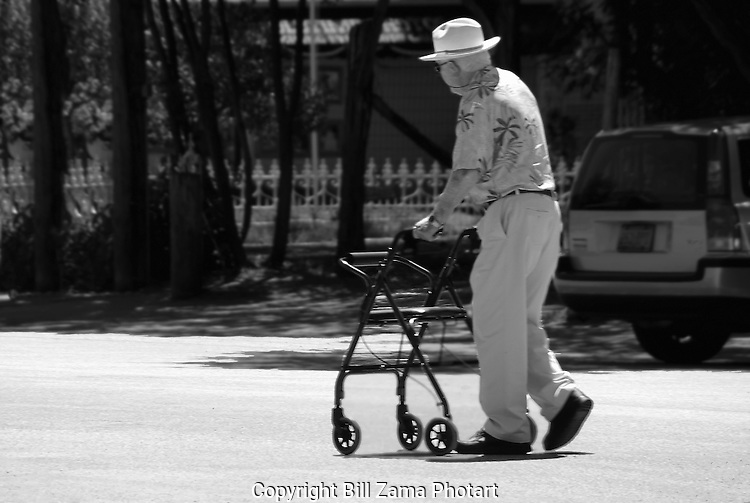 Elderly gentleman crossing through the main intersection of Gruene TX