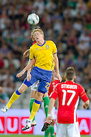 Sweden's Rasmus Elm (front) fights for the ball during the UEFA EURO 2012 Group E qualifier Hungary playing against Sweden in Budapest, Hungary on September 02, 2011. ATTILA VOLGYI