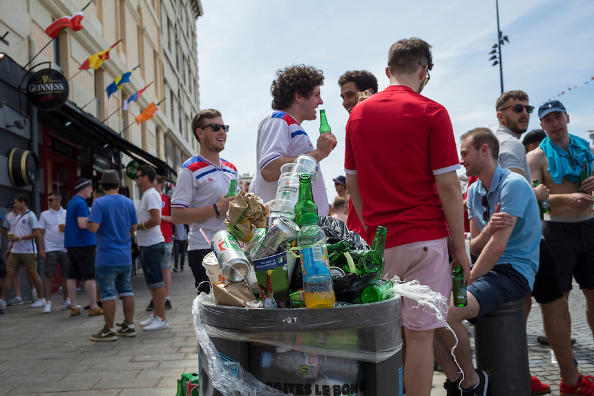 Rubbish bins overflow with beer can and bottles as England fans enjoy the pre-match build up in Marseille old town before the game<br /> <br /> Photographer Craig Mercer/CameraSport<br /> <br /> International Football - 2016 UEFA European Championship - Group B - England v Russia - Saturday 11th June 2016 - Stade Velodrome, Marseille - France <br /> <br /> World Copyright &copy; 2016 CameraSport. All rights reserved. 43 Linden Ave. Countesthorpe. Leicester. England. LE8 5PG - Tel: +44 (0) 116 277 4147 - admin@camerasport.com - www.camerasport.com