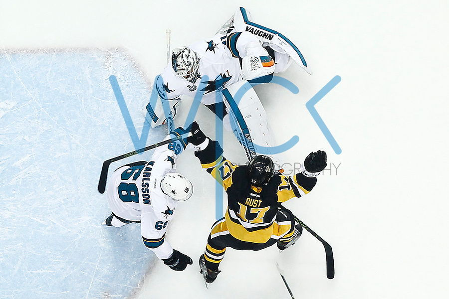 Bryan Rust #17 of the Pittsburgh Penguins celebrates his goal past Martin Jones #31 of the San Jose Sharks in the first period during game one of the Stanley Cup Final at Consol Energy Center in Pittsburgh, Pennslyvania on May 30, 2016. (Photo by Jared Wickerham / DKPS)