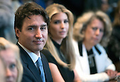 Prime Minister Trudeau of Canada is seated next to Ivanka Trump during a roundtable with President Donald Trump on the advancement of women entrepreneurs and business leaders, at the White House in Washington, D.C. on February 13, 2017. <br /> Credit: Kevin Dietsch / Pool via CNP