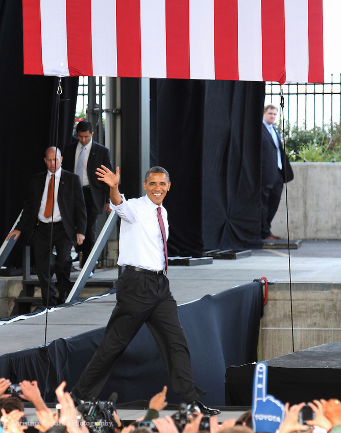 September 22, 2012- Milwaukee, United States: President Barack Obama enters the stage at the Summerfest grounds. Obama was greeted by thousands of supporters at the political rally held Saturday as part of his campaign in Wisconsin. (Christina Capasso/Polaris)