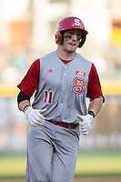 Andrew Knizner (11) of the North Carolina State Wolfpack rounds the bases after hitting a home run against the Charlotte 49ers at BB&T Ballpark on March 31, 2015 in Charlotte, North Carolina.  The Wolfpack defeated the 49ers 10-6.  (Brian Westerholt/Four Seam Images)