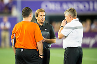Orlando, Florida - Saturday, April 23, 2016: Houston Dash head coach Randy Waldrum discusses the 1-3 loss with his staff after an NWSL match between Orlando Pride and Houston Dash at the Orlando Citrus Bowl.