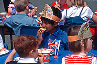 Schoolchildren sitting at tables eating their lunch time meal celebrating the Queens Golden Jubilee 2002. This image may only be used to portray the subject in a positive manner..©shoutpictures.com..john@shoutpictures.com